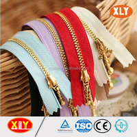 2016 hot sale gold teeth close end metal zipper , bag zipper