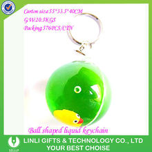 arylic ball shaped oem floater logo oil 2012 promotional liquid filled keychain