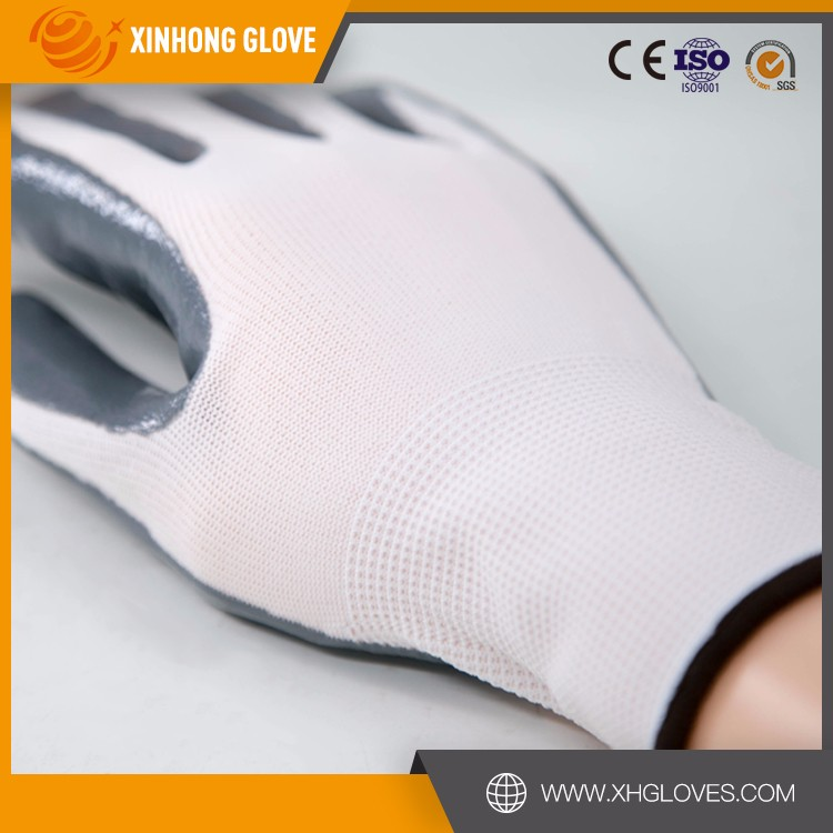 Xinhong 2015 Working safety gloves 13G nylon liner nitrile palm dip