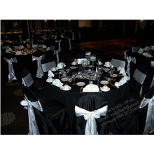 Black polyester table cloth and chair covers with white satin chair sash
