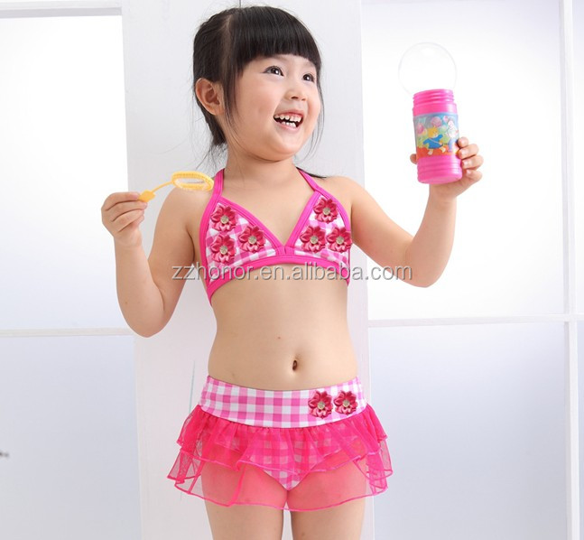 Korea design girl swimwear with cap/baby separate beach wear / floatation suit