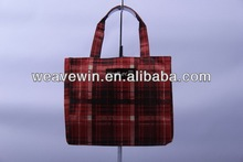 Red hued chequered design shopping bag