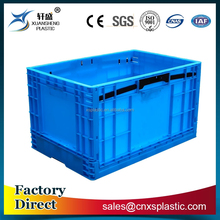 Solid plastic foldable container for industrial use