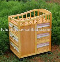 wood cabinet with willow drawers and top