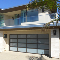 Sectional tilt up glass garage doors