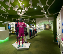 Sports wear store interior design with decorative footballs