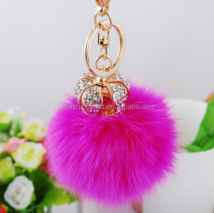 High quality crown keychain with pompons