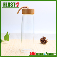 clear round empty glass water bottles sports drinking bottles