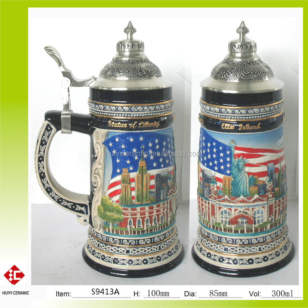 Embossed and handpainted ceramic beer stein with pewter lid