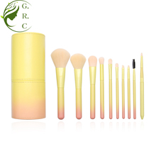 Custom 10pcs wooden handle nylon hair pink yellow gradient makeup brushes set with cylinder case