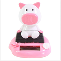 Customized OEM Pig Sitting on Log Forest Chinese Zodiac Solar Powered Nodding Toys/Plastic Dancing Bobble Head Toys
