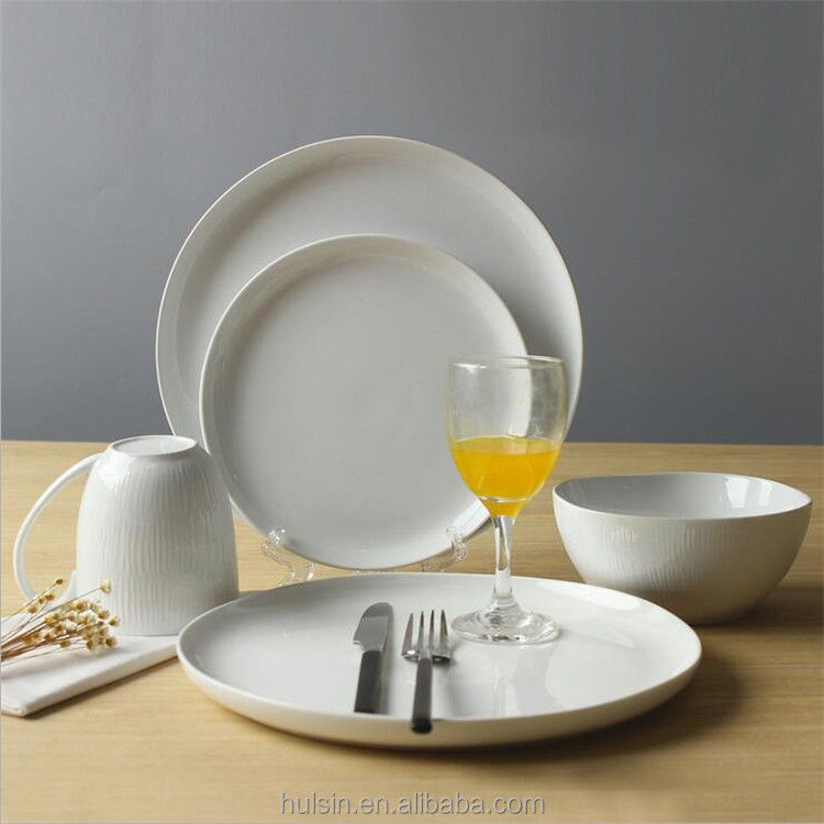 High quality unique shape ceramic porcelain dinnerware pure white round embossed dinner sets 16 pcs dinnerware in stock