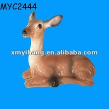 Painted ceramic sitting deer figurine