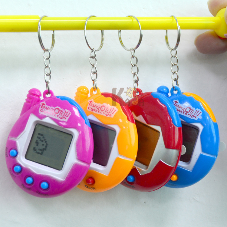 Dinosaur Egg Virtual Pets on a Keychain Digital Pet Electronic Game