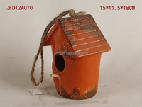 orange fancy ceramic bird cage