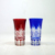 Set of two Japanese cut blue and red shot glasses with wooden box