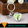 /product-detail/china-manufacturer-silver-finish-customzied-pictures-heart-shape-glass-key-chain-60395168806.html