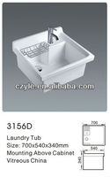 white porcelain mounting above cabinet laundry tub