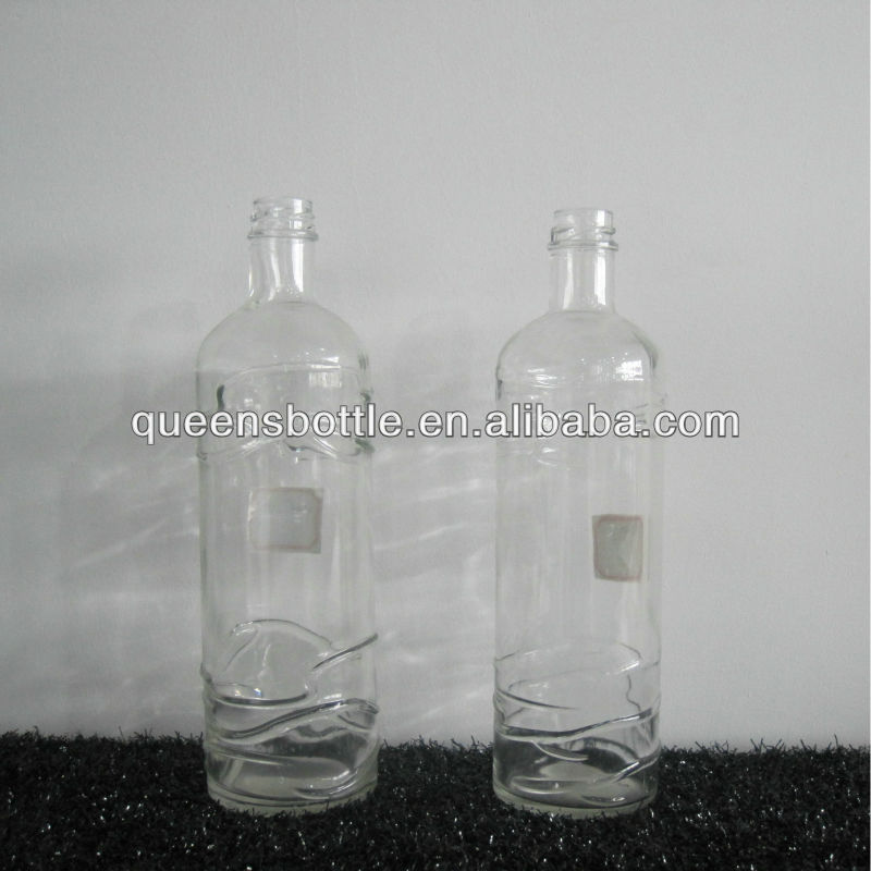 Surface engraved glass bottle for sweet liqueur