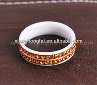 New beautiful fashionable white ceramic rings with yellow / orange cz diamond