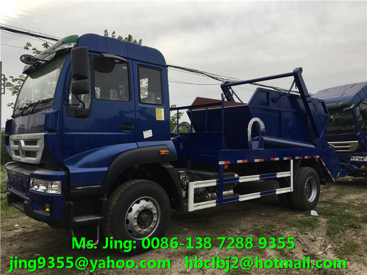 Hot selling SINOTRUK 10-12cbm double arm roll collecting garbage trucks in Angola