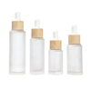 /product-detail/printing-logo-cosmetic-20ml-25ml-30ml-50ml-frosted-glass-essential-oil-bottle-with-bamboo-look-plastic-dropper-62412106229.html