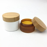 Cosmetic skin care empty plastic jar with bamboo cap