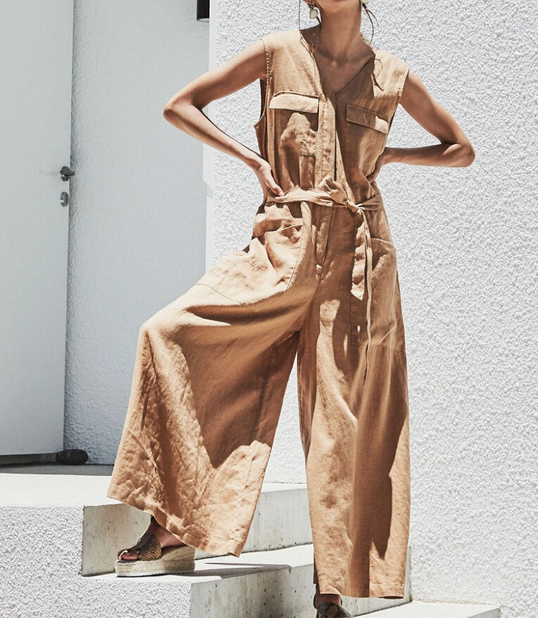 Women relaxed sleeveless military style jumpsuit with v-neckline belt and a wide-leg pant