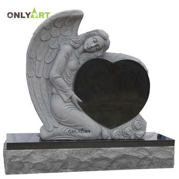 Female Angel Holding Black Heart Shape Headstones