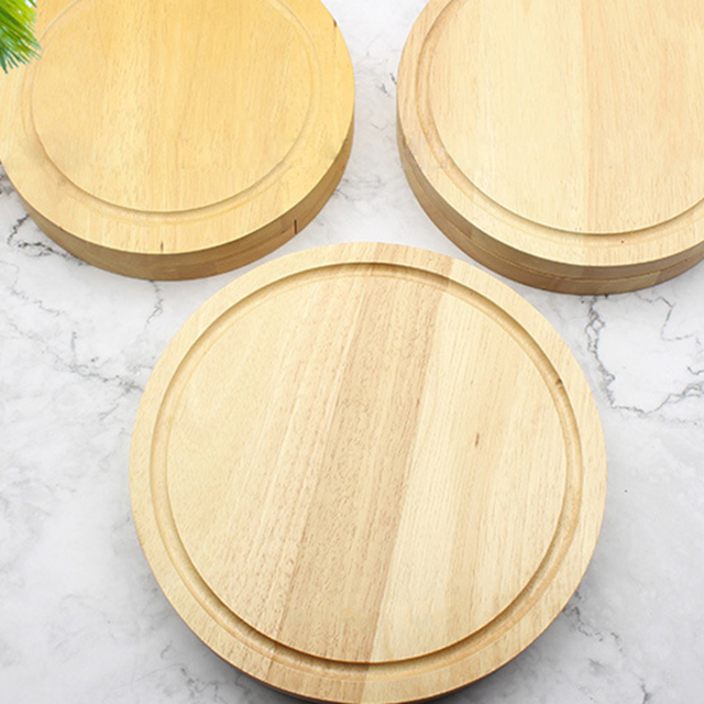 Unscrewed rubber wood box set with 4 piece knife set round cheese board