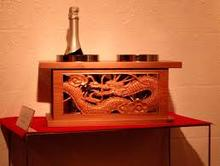 Japanese wine cooler decorated with traditional wooden dragon shaped-sculpture for home looking for distributor giant wine glaas
