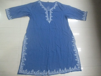 100% Cotton dyed kaftan with wool embroidery.