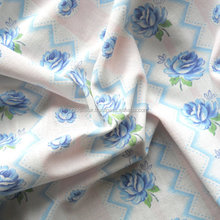 vintage fabric for patchwork handmade quilt blue roses and pink printed handmade patchwork quilt