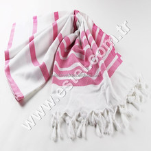 Magenta Chevron Design It is flat-woven with hand-tied fringe, typically made of Turkish cotton