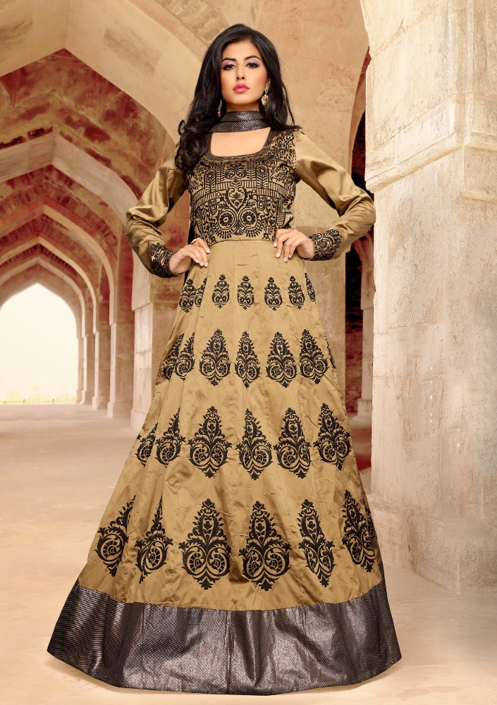 Beige Colored Taffeta Silk Heavy Embroidered Festive Wear Suit.