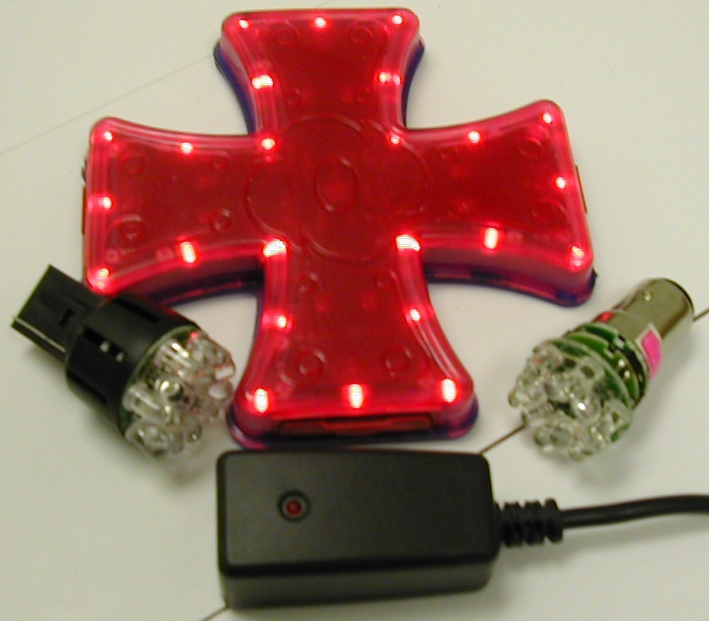 Wireless iron Cross brake light for saddle bags in motorcycle