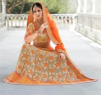 Orange color net saree wih stone work Fancy Designerlace lehenga Saree with fancy blouse .