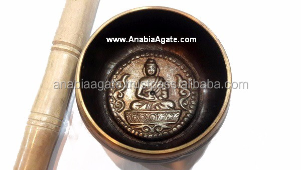 Wholesale Tibetan singing bowls With Embossed Buddha from India | Sound Healing Bowls From Anabia Agate Exports