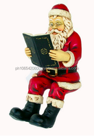 Santa sitting with book. ID:1976