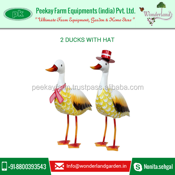 Perfectly Created Ducks with Hat Decoration to Brighten your Garden at Best Market Rate