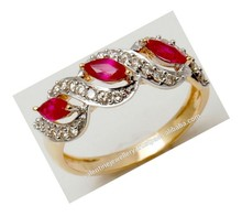Marquise cut ruby diamond gold ring design