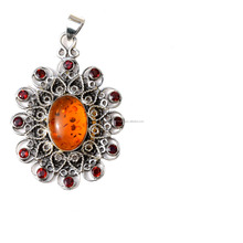 Appealing silver- 925 sterling silver jewelry 2016 with natural amber cabochon gemstone and garnet cut stone pendant