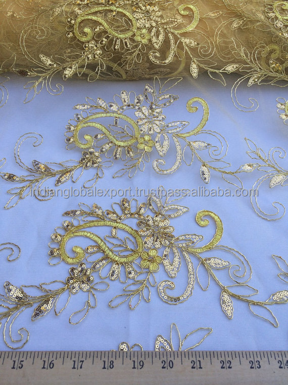 Golden elegant embroidered sequined floral fabric