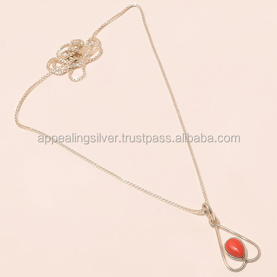 Designer silver jewelry with natural red coral gemstone pendant