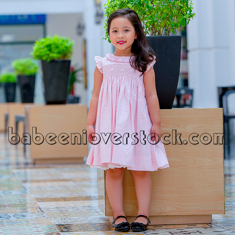 Cute pink geometric and tiny flower girl smocked dress