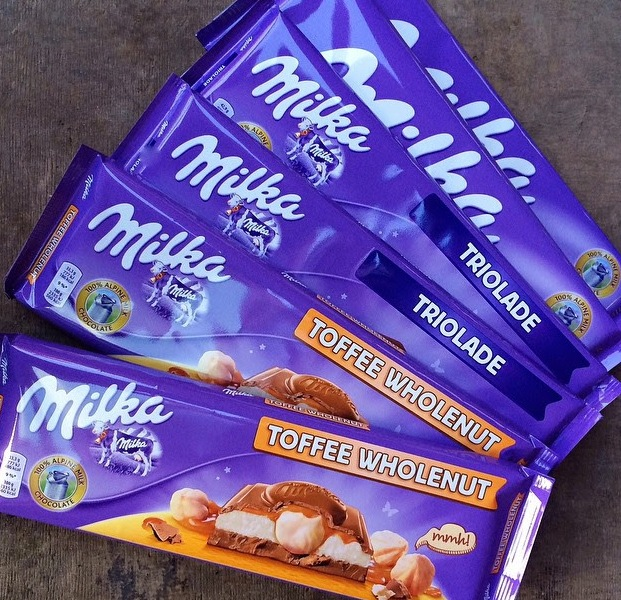 MILKA 100 GR,300 GR Raisin & Nuts/Milka chocolate bar with whole hazelnuts
