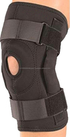 Compression neoprene knee support with adjustable spring support and compression silicon pad