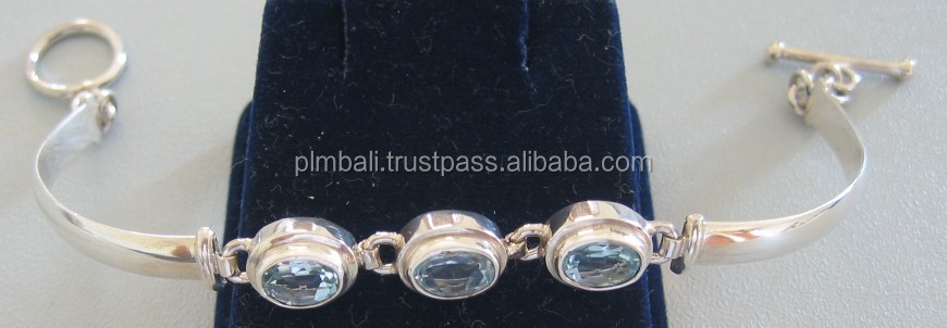 SBR005-Multi stone bracelet with 3 double bezel of 4x6 mm oval faceted Sky Blue Topaz- toggle lock