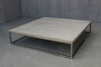 Stainless steel center table with a concrete top