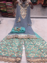 semi stitched georgette with stitched pure sharara dupatta